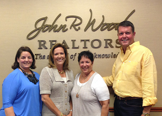 Creig and Carla Northrop with members of the John R. Wood Team